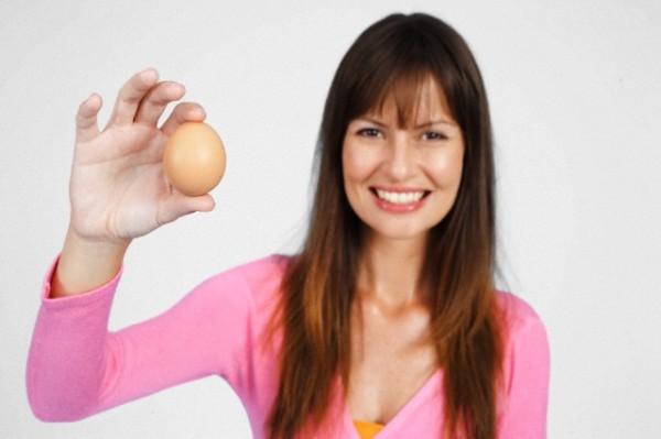 Woman holding an egg