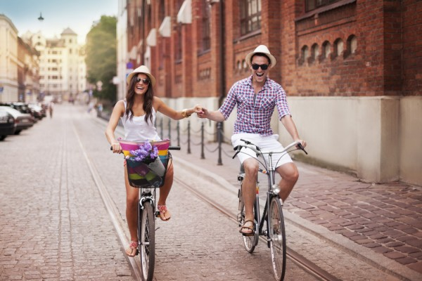 People-Happy-Couple-Biking-in-the-City-during-Summer-Medium