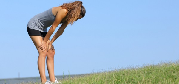 TiredWomanLeaningOnKneesAfterWorkout-850x400