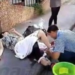 China Women Giving Birth To Her Baby On The Street