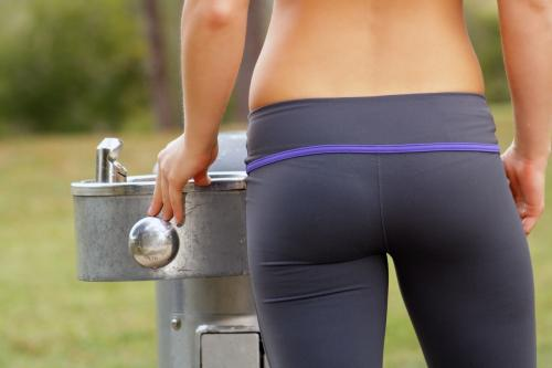 beautiful-female-athlete-at-a-water-fountain-2