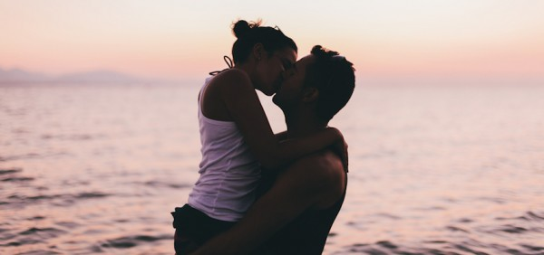 Couple on the Beach Kissing at Sunset