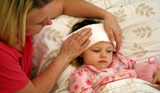 mother taking care of sick child