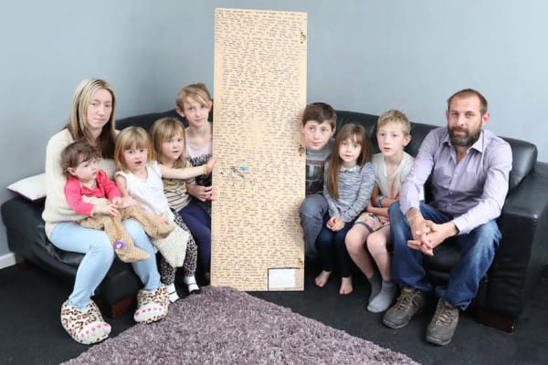 PIC FROM CATERS NEWS - (PICTURED: Mum Caroline, Naysa 1, Letissia-Dior 2, Indika-Mayah 4, Porscha, Ethan 11, Tiana 5,Harley 8 and dad Dean with the message on the back of the mirror) -A 12-year-old girl who died following a battle with cancer left a heart-wrenching secret message hidden on the back of her mirror. Athena Orchard, died last Wednesday (May 28) after losing her fight with the terminal disease. Just days after her death, Athenas dad Dean was stunned to discover a giant heartfelt note written in marker pen on the back of his daughters mirror. The message was written after Athena was diagnosed with cancer - which she discovered after finding a tiny lump on her head in December last year. Before she died, she penned the lengthy message which remained undiscovered until days after her death. SEE CATERS COPY.